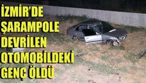 İZMİR'DE ŞARAMPOLE DEVRİLEN OTOMOBİLDEKİ GENÇ ÖLDÜ